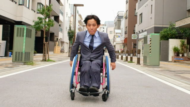 japanese man in a wheelchair - wheelchair stock videos & royalty-free footage