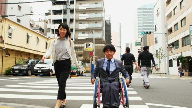 japanese man in a wheelchair - disability worker stock videos & royalty-free footage