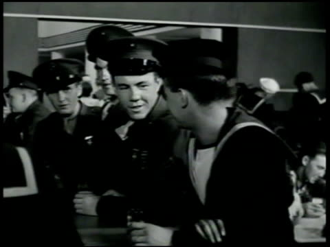 japanese man looking through door window. u.s. marines & navy sailors at bar. japanese man walking to bar, bumping marine, marine about to fight,... - 1942 stock videos & royalty-free footage