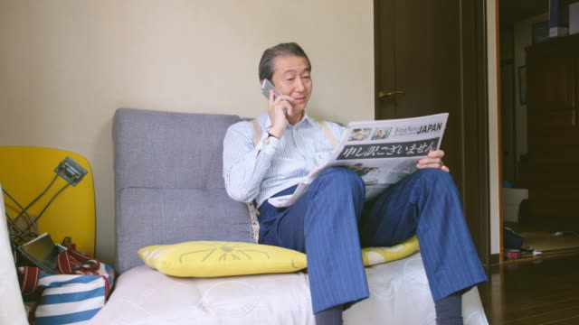 japanese man reading newspaper - old newspaper stock videos and b-roll footage