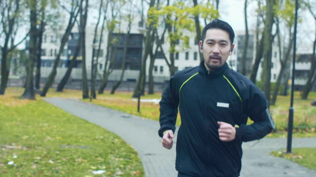 japanese man runs in a rainy day (slow motion) - jogging stock videos & royalty-free footage