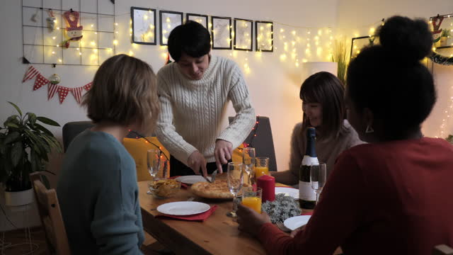 japanese man serving dinner to friends and family during christmas - meal stock videos & royalty-free footage
