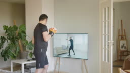 Japanese man taking online boxing lessons during lockdown in isolation