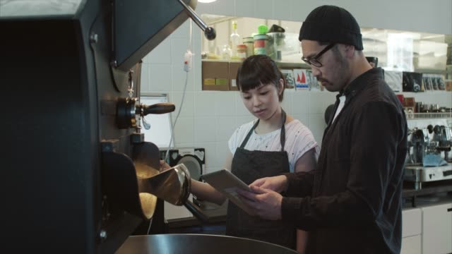 japanese man teaches apprentice how to roast coffee (slow motion) - 30 39 years stock videos & royalty-free footage