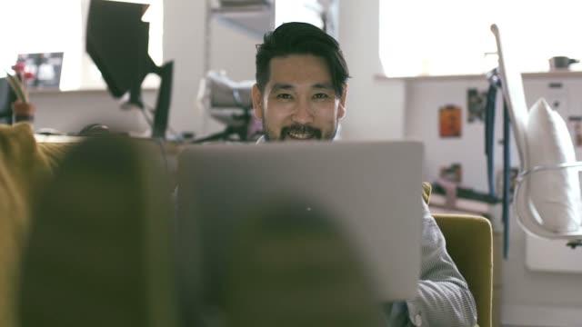 japanese man using laptop - fashionable stock videos & royalty-free footage
