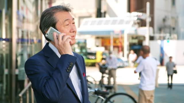 Japanese Man using Telephone