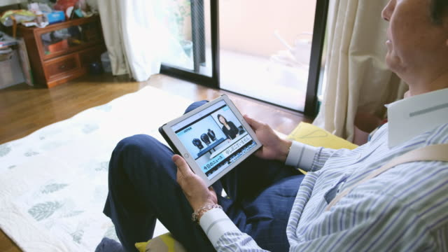 japanese man watching online news - the media stock videos & royalty-free footage