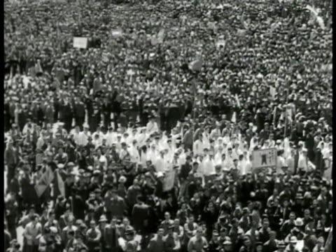 japanese mass meeting crowd. communist party member sanzo nosaka talking. japanese soldiers watching. crowd cheering w/ banners. japanese man waving... - communist flag stock videos & royalty-free footage