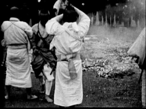 japanese men testing their mettle and bravery by walking or running barefoot across hot coals some carrying daito katana long blade samurai swords in... - samurai stock videos & royalty-free footage