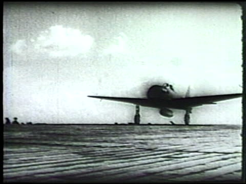 japanese mitsubishi a6m 'zero', 'zeke' fighter airplane taking off from aircraft carrier . tracking formation of fighter aircrafts flying over... - pacific war video stock e b–roll