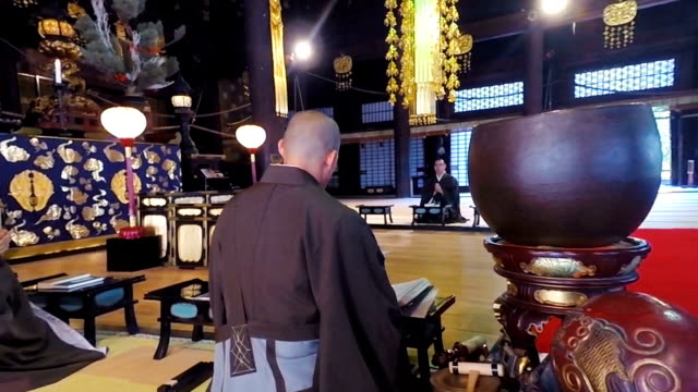 Japanese Monks Praying and Chanting in a Buddhist Temple