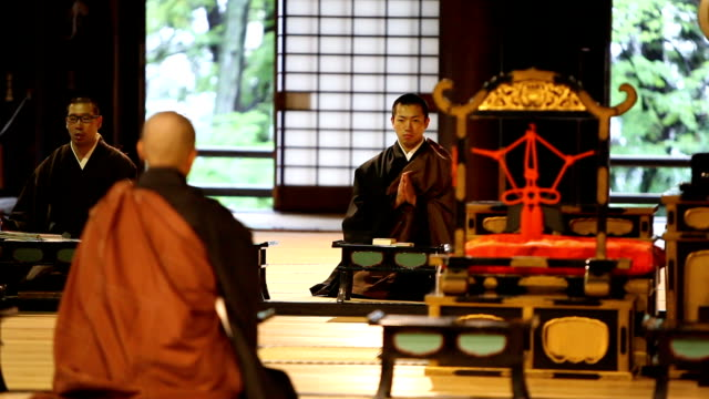 Japanese Monks Praying in a Buddhist Temple