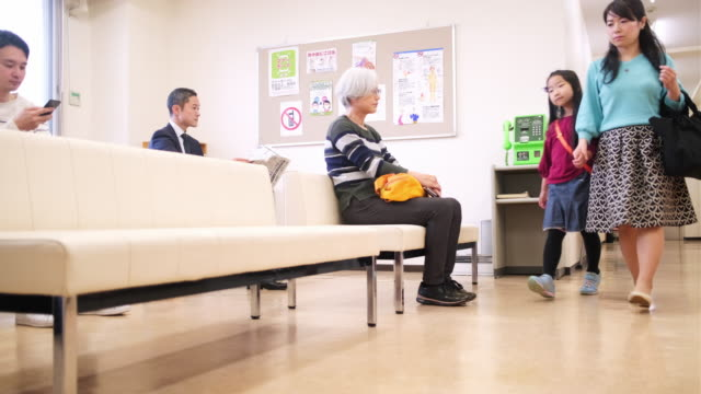 japanese mother and daughter arriving in waiting room - waiting room stock videos & royalty-free footage