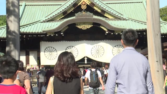 japanese mps visit yasukuni war shrine a historically controversial site where senior convicted war criminals are honoured on the anniversary of... - japanese surrender stock videos and b-roll footage