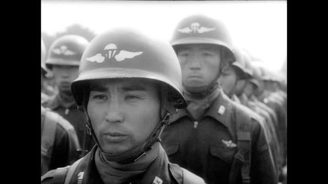 / japanese national self defense force celebrates 10th anniversary / both female and male recruits stand to attention / dignitaries watch parade /... - 1960年点の映像素材/bロール