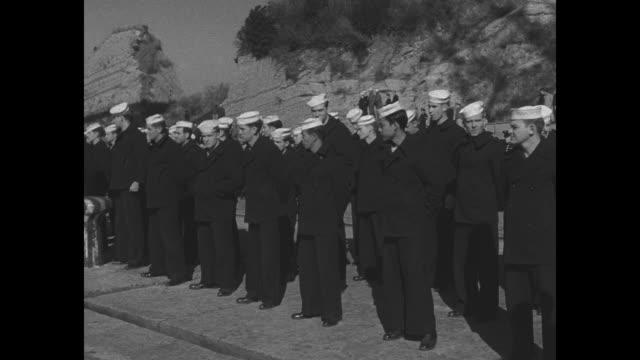 japanese navy band plays at ceremony involving us loan of ships to japan / japanese naval officers walk up gangplank of ship / japanese sailors walk... - marinaio video stock e b–roll