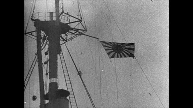 Japanese Navy battleship in harbor WS Japanese flag on crow's nest HA WS Launch boat approaching ship MS Naval officer CU Sailors MS Naval officers...