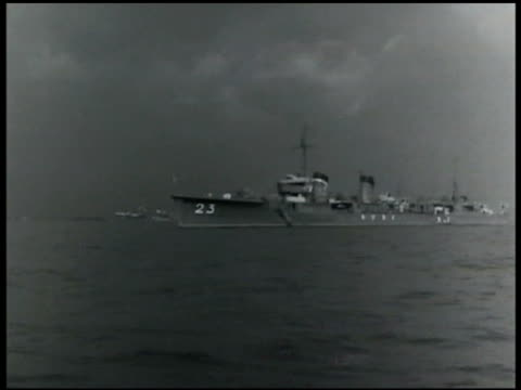 japanese navy battleships on sea japanese soldiers in full uniform marching together in parade formation officials standing on reviewing platform w/... - 軍艦点の映像素材/bロール