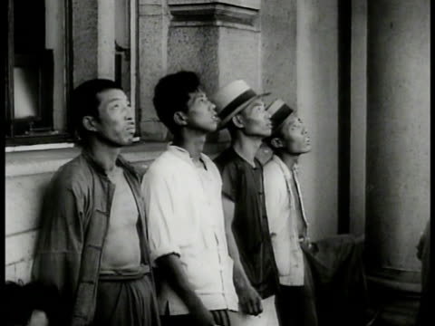 japanese navy ship in harbor ws chinese men standing against the wall looking up la xws fighter airplanes cu cannons firing from ship xla ws fighter... - 1937 stock videos & royalty-free footage
