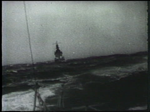 japanese navy ships navigating through rough seas vs officer on deck looking w/ binoculars ws line of warships at sea wwii world war ii pacific front... - aleutian islands stock videos and b-roll footage