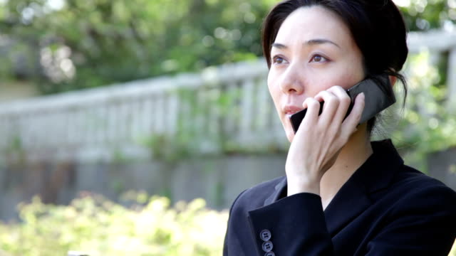 Japanese Office Lady Talking in Telephone