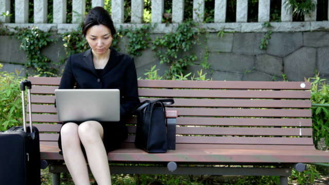 Japanese Office Lady Working with Laptop