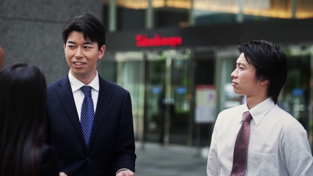 Japanese Office Workers Chatting
