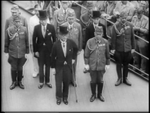 japanese officers in tuxedos uniforms standing at surrender of japan on uss missouri - japanese surrender stock videos & royalty-free footage