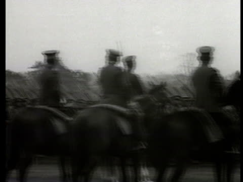 japanese officers on platform steps reviewing soldiers marching by. war minister sadao araki standing behind desk. vs imperial japanese navy ships... - manchuria stock videos & royalty-free footage