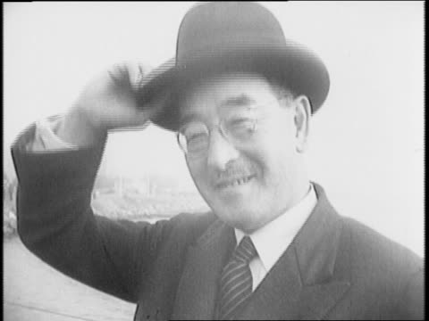 japanese official sabur_ kurusu exits pan american flight in san francisco / kurusu doffs his hat / kurusu meets talks to reporters in room /... - social grace stock videos & royalty-free footage