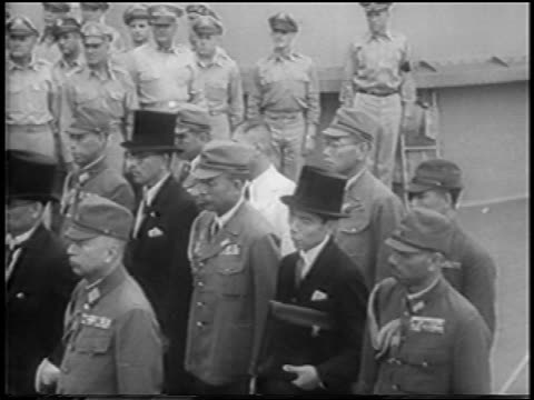 japanese officials in tuxedos uniforms standing at japan's surrender on uss missouri - japanese surrender stock videos & royalty-free footage