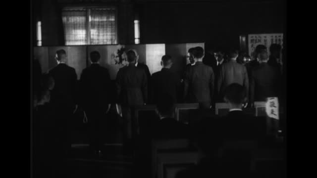 japanese officials reward metal production efforts and promote a metal recovery campaign in tokyo during world war ii - gesellschaftliche mobilisierung stock-videos und b-roll-filmmaterial