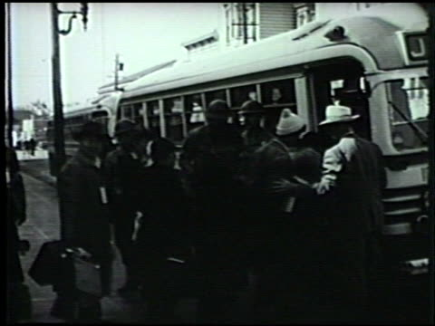 japanese people carrying luggage lining up on street to board greyhound bus. japanese people waving goodbye to bus leaving. wwii, world war ii, pearl... - japanese ethnicity stock videos & royalty-free footage