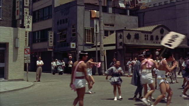 ms pov japanese people celebrate their ceremonies on street - 1961 stock-videos und b-roll-filmmaterial