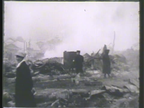 japanese people scattered through devastated town debris smoke fire people going through rubble natural disaster hoshu casualties survivors - 1923 stock videos & royalty-free footage