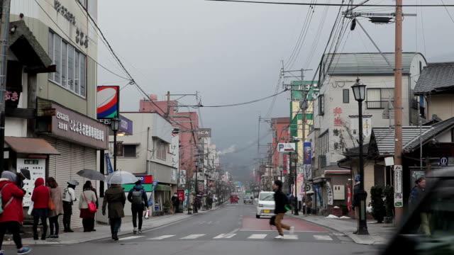 japanese people walks in snow storm in yufuin fukuoka, japan - fukuoka prefecture stock videos & royalty-free footage