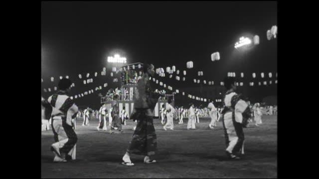 japanese performers wear traditional costumes as they dance at yokohama's japan-u.s. goodwill bon festival. - yukata robe stock videos & royalty-free footage