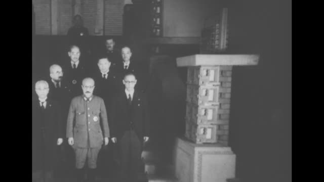 stockvideo's en b-roll-footage met ms japanese prime minister general hideki tojo on steps with other japanese officials / cu tojo as flashbulbs go off / ms tojo with his top cabinet... - prime minister
