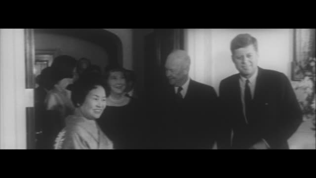 Japanese Prime Minister Hayato Ikeda in the US/Prime Minister Hayato Ikeda and his wife descend ramp 2 daughters studying in US greet them VP Johnson...