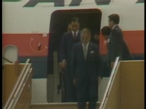 japanese prime minister yasuhiro nakasone and his entourage depart a plane at the marco polo airport - (war or terrorism or election or government or illness or news event or speech or politics or politician or conflict or military or extreme weather or business or economy) and not usa video stock e b–roll