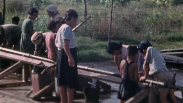 japanese prisoners gathering water in camp / saipan mariana islands - mariana islands stock videos and b-roll footage