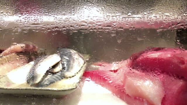 Japanese raw food salmon and tuna show in sushi sashimi bar and japanese restaurant