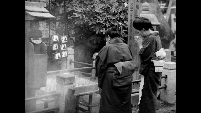 japanese religious procession temple bg. women praying at altar. elderly man taking incents. woman inserting incent into shrine. women praying. - schrein stock-videos und b-roll-filmmaterial