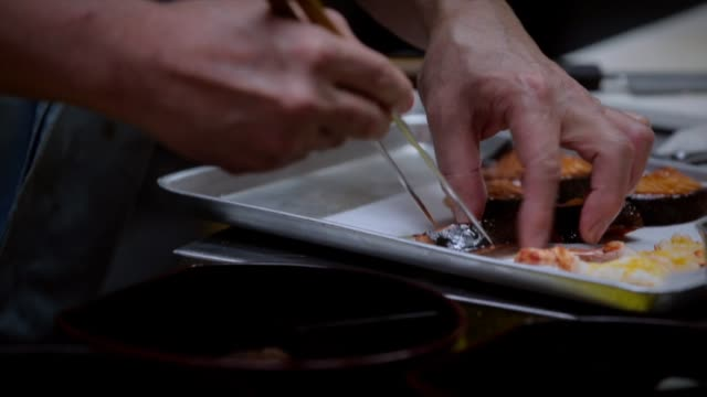 japanese restaurant prepares gourmet bento boxes in world's most expensive city on february 14, 2013 in tokyo, japan. japanese restaurant prepare... - expense stock videos & royalty-free footage