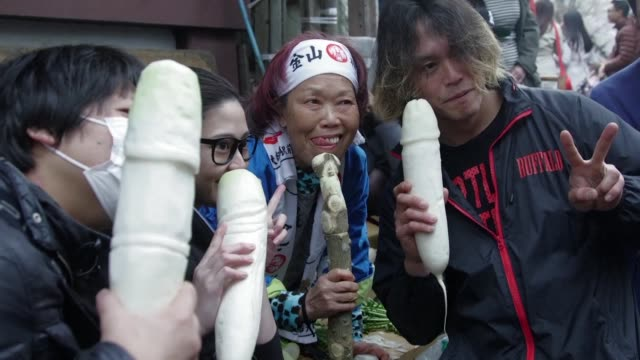 japanese revellers carry giant phalluses through the streets of kawasaki to worship the humble penis and fertility in one of the world's most unusual... - penis stock videos & royalty-free footage