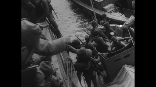 japanese rising sun flag flying from ship's mast / japanese soldiers climbing down from side of boat and getting into smaller one, vo narration in... - japan flag stock videos & royalty-free footage