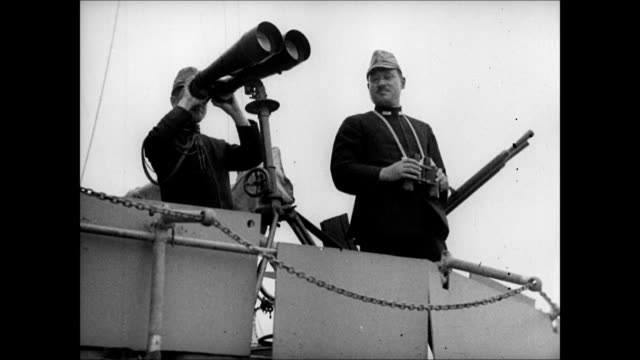 vídeos de stock e filmes b-roll de japanese river boat mountain bg la ws japanese naval officers w/ binoculars ws harbor ships china vs japanese soldiers arriving on boat unloading ha... - binóculos