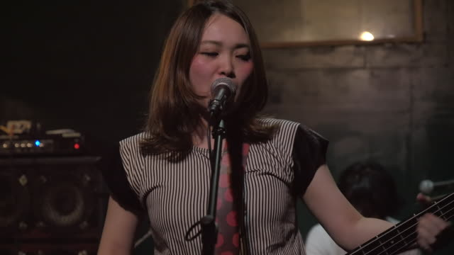 japanese rock band performing on stage. - rock group stock videos & royalty-free footage