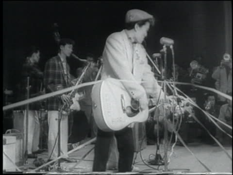 b/w 1958 newsreel japanese rockabilly band playing on stage at concert / tokyo - klassischer rock and roll stock-videos und b-roll-filmmaterial