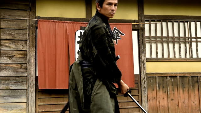 japanese ronin warrior draws his blade - mid adult men stock videos & royalty-free footage